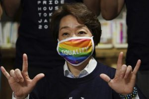 Japanese Olympic Chief Witch Does Occult Hand Sign in LGBTQ Event, Wants to Spread The Homo
